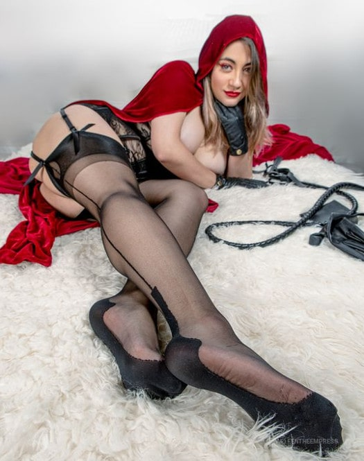 whip humiliatrix teasing legs in garters