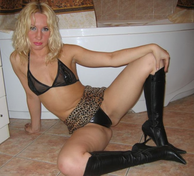 dominant stripper teasing bra, thong, & knee-high boots
