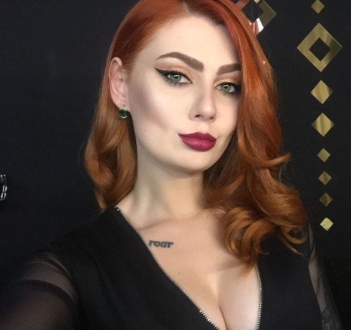 red lipstick on redhead mistress