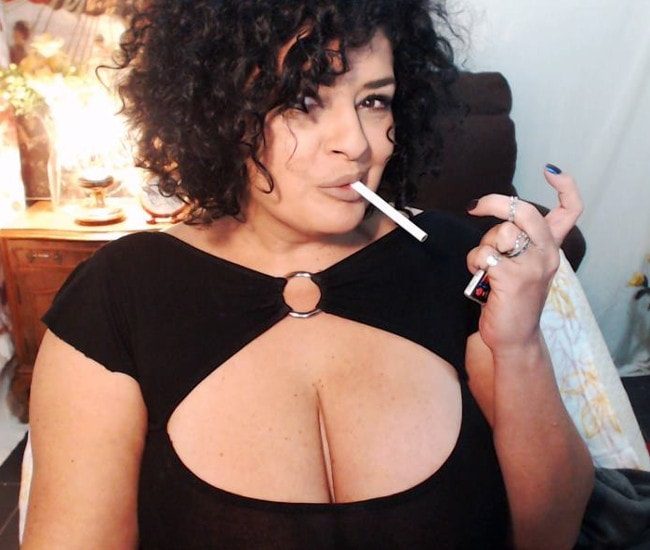 busty mature mistress smokes cigarette