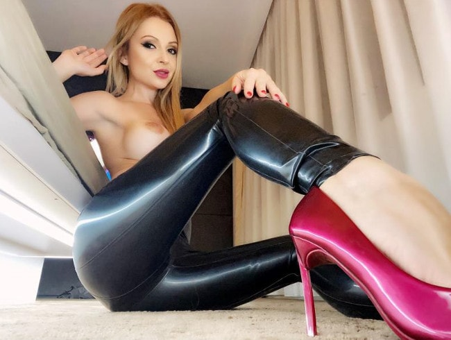 topless humiliatrix poses in leather pants & pink heels