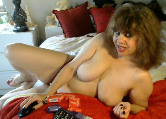 topless chubby mistress spreads on bed