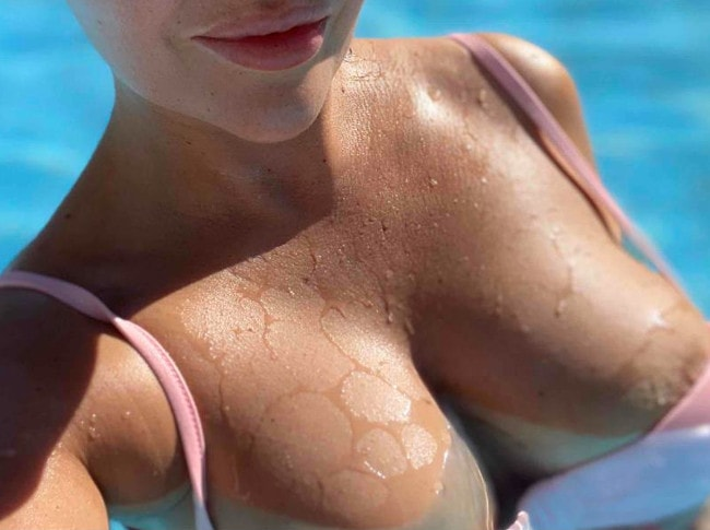 tanned tits in bikini posing
