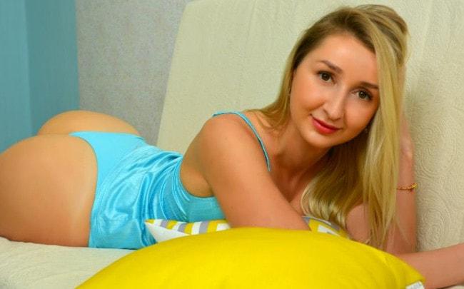 pretty blonde poses in aqua swimsuit