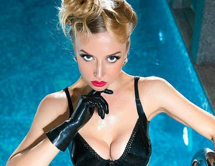 blonde domme posing in latex bra & gloves