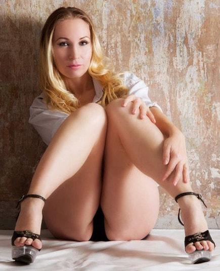 kinky blonde femdom mistress spreads sexy feet in heels
