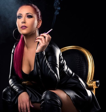 leather mistress smoking cigarette