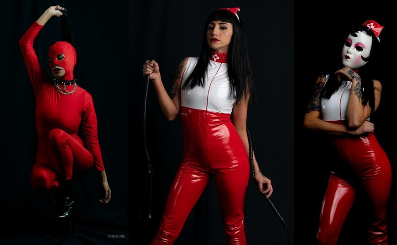fetish mistress showing off red latex body suit
