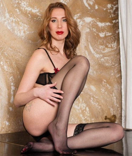 redhead red lips mistress teasing legs in pantyhose