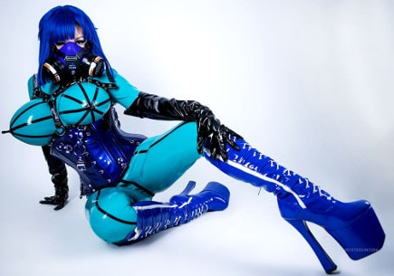 latex fetish mistress decked in full-body latex suit